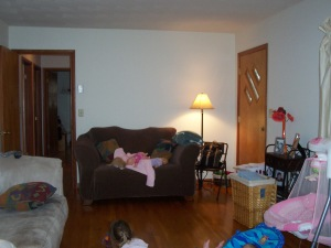 Opposite end of living room. Check out that front door! The other doorway takes you down our hall.