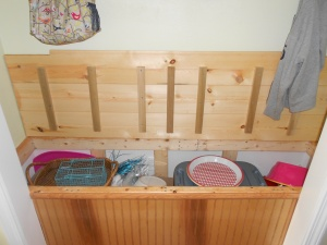 The bench opens up and makes a huge storage space for my outside party supplies.