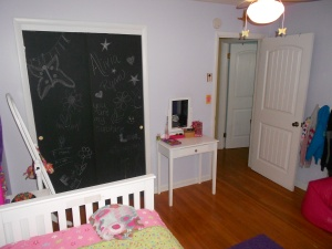 We painted her brown sliding closet doors with chalk board paint. They do look much better than they did.