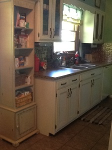 "Same old cabinets, but we used Kitchen Tune-up to ""tune them up."" New countertops from Lowes."