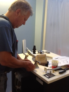 Kristi's dad preparing the new faucet. She's very blessed to have such a wonderful father!