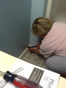 You go girl! Kristi putting in new baseboards.